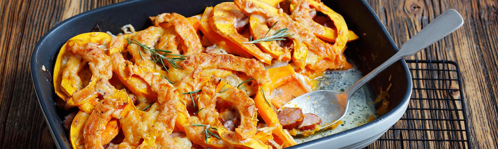 Headerabbildung für das Rezept Kürbis- und Süßkartoffelgratin mit Wurst
